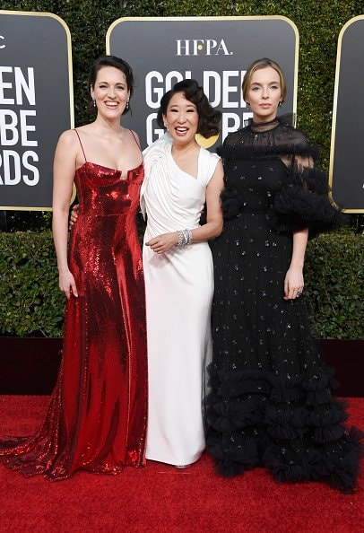 BEVERLY HILLS, CA - JANUARY 06:  (L-R) Phoebe Waller-Bridge, host Sandra Oh, and Jodie Comer attend the 76th Annual Golden Globe Awards at The Beverly Hilton Hotel on January 6, 2019 in Beverly Hills, California.  (Photo by Frazer Harrison/Getty Images)
