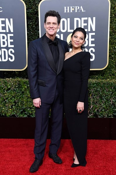 BEVERLY HILLS, CA - JANUARY 06:  Jim Carrey (L) and Ginger Gonzaga attend the 76th Annual Golden Globe Awards at The Beverly Hilton Hotel on January 6, 2019 in Beverly Hills, California.  (Photo by Frazer Harrison/Getty Images)