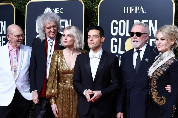 BEVERLY HILLS, CA - JANUARY 06:  (L-R) Jim Beach, Brian May of Queen, Lucy Boynton, Rami Malek, Roger Taylor of Queen, and Sarina Potgieter attend the 76th Annual Golden Globe Awards at The Beverly Hilton Hotel on January 6, 2019 in Beverly Hills, California.  (Photo by Frazer Harrison/Getty Images)