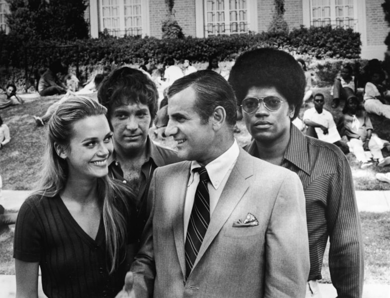 Promotional portrait of actors (L-R): Peggy Lipton, Michael Cole, Tige Andrews and Clarence Williams III on a university campus for the television series, 'The Mod Squad,' c. 1968. (Photo by ABC/Hulton Archive/Courtesy of Getty Images)